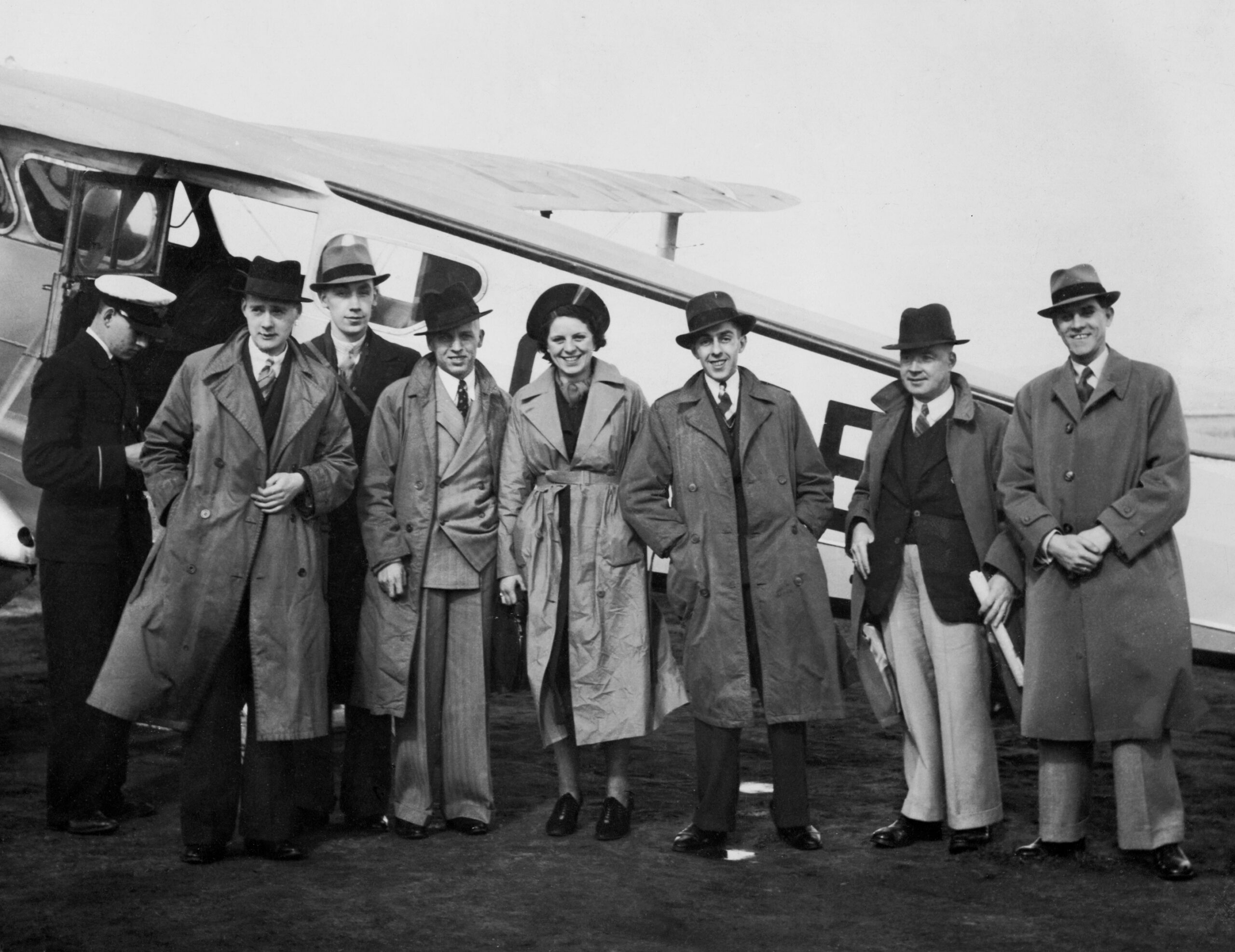 Photograph of passengers about to board a de Havilland Dragon Rapide in 1938 - 2019 scan of the photo after repair
